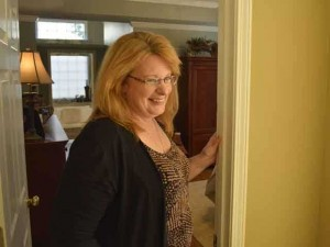 Terri Wylie in her newly designed and organized space. Courtesy of Forsyth News.